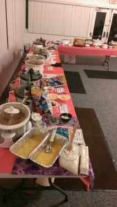 A wide variety of chilies and sides stand ready for judging.