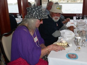 """Danny """"Gilligan"""" McGehee has his eyes on Marie """"Lovey"""" Taylor's birthday cheesecake."""
